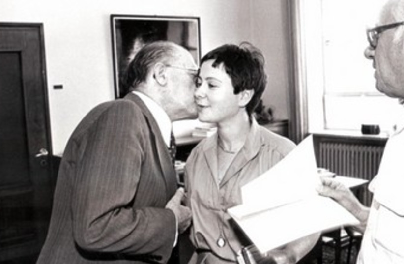 Sarah Honig gets a kiss from Prime Minister Menachem Begin (photo credit: Courtesy)