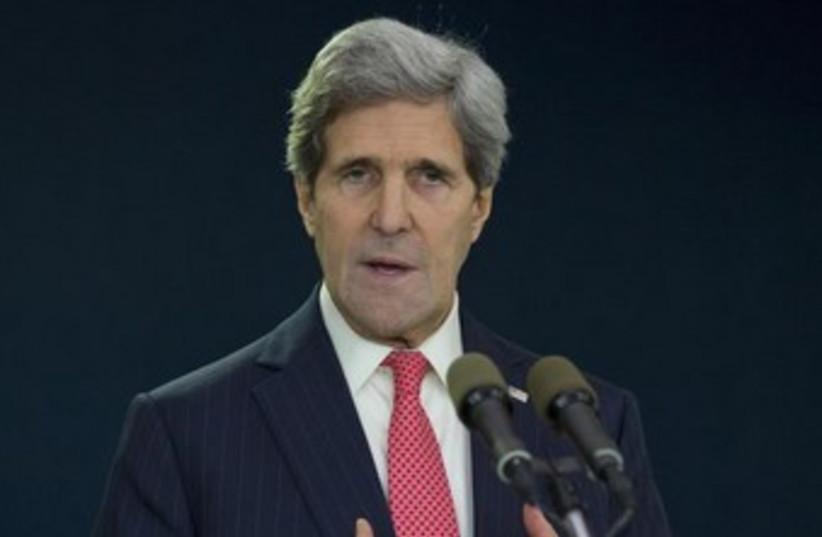 US Secretary of State John Kerry before his departure at Ben Gurion Airport, December 6, 2013. (photo credit: REUTERS/Pablo Martinez Monsivais/Pool)