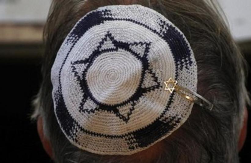 Head with Israeli flag kippa (photo credit: REUTERS/Ina Fassbender)