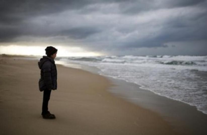 An Israeli girl stands on Zikim beach 370 (photo credit: REUTERS)