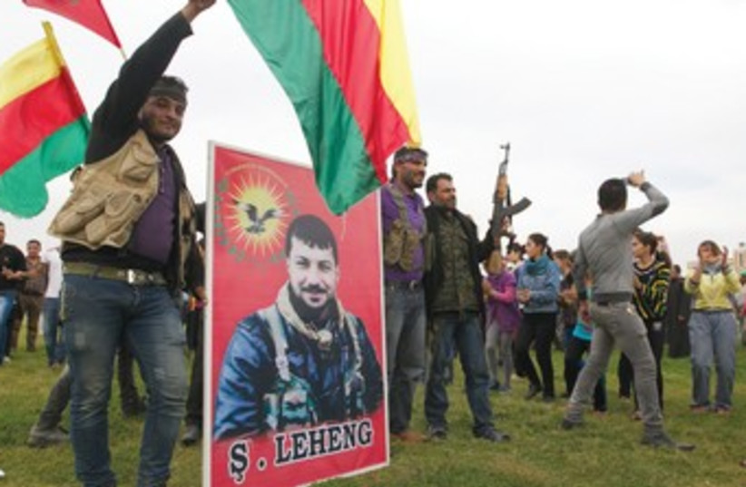Kurds celebrate 370 (photo credit: Reuters)