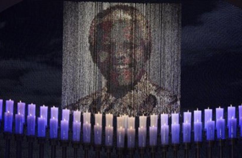 Candles lit at Mandela's funeral 370 (photo credit: REUTERS/Odd Andersen/Pool)