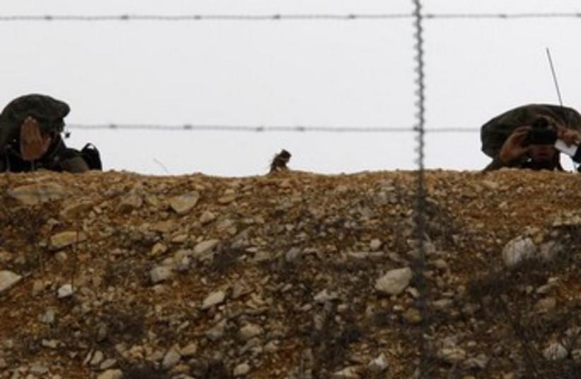 IDF soldiers on Lebanon border 3 370 (photo credit: REUTERS/Ali Hashisho )