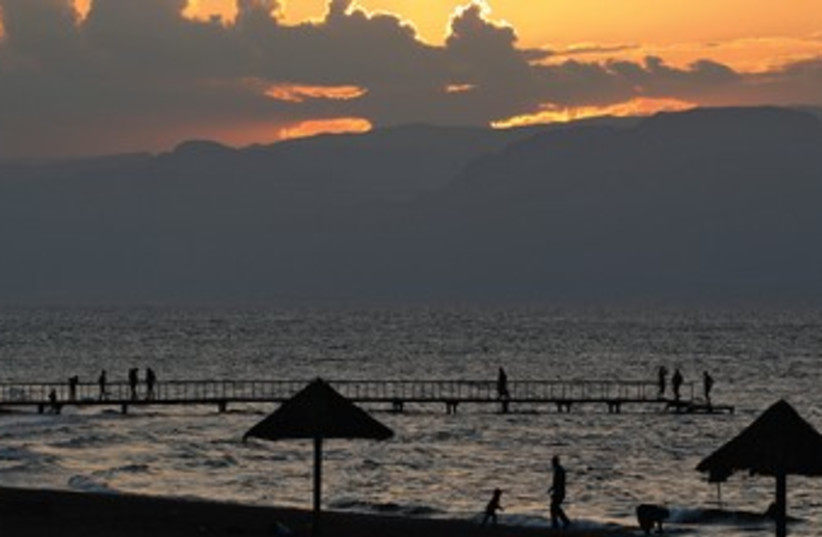 The sun sets over the Gulf of Aqaba 370 (photo credit: Reuters)
