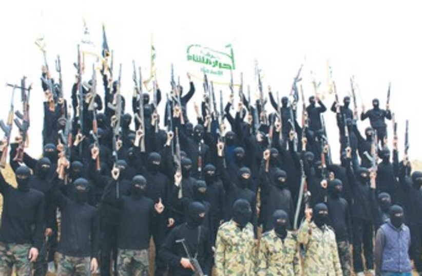 Syrian Islamist fighters 370 (photo credit: REUTERS)