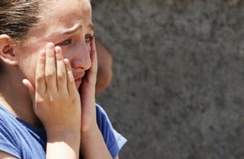 girl crying 370 (photo credit: reuters)