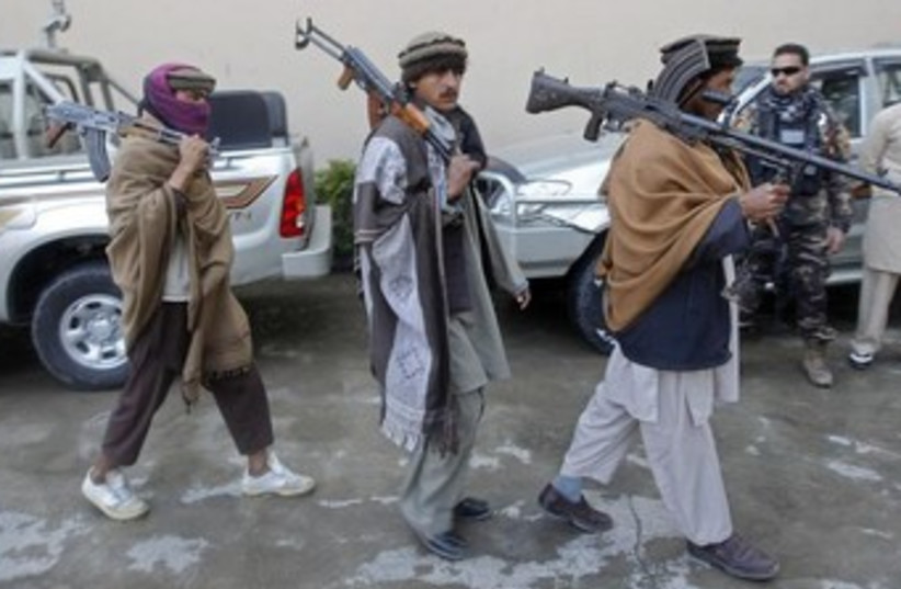 Taliban militants with weapons 370 (photo credit: REUTERS/Parwiz)