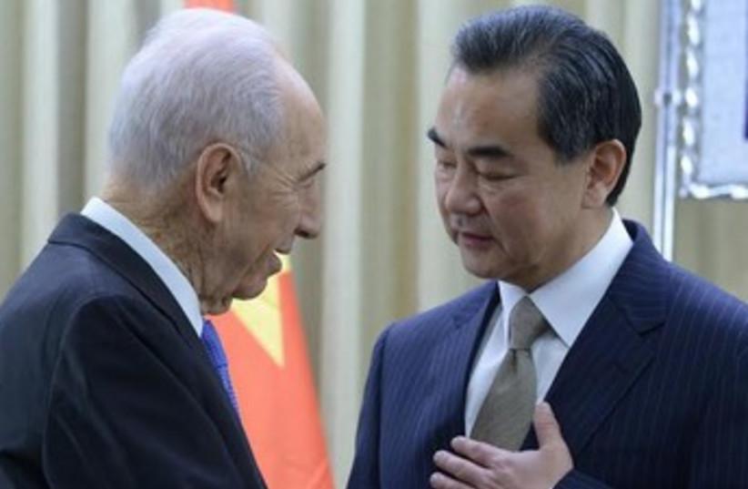 Peres and Chinese FM Wang Yi 370 (photo credit: Mark Neiman, GPO)