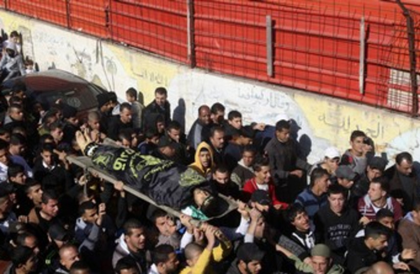 Jenin body carried to funeral (photo credit: Reuters)