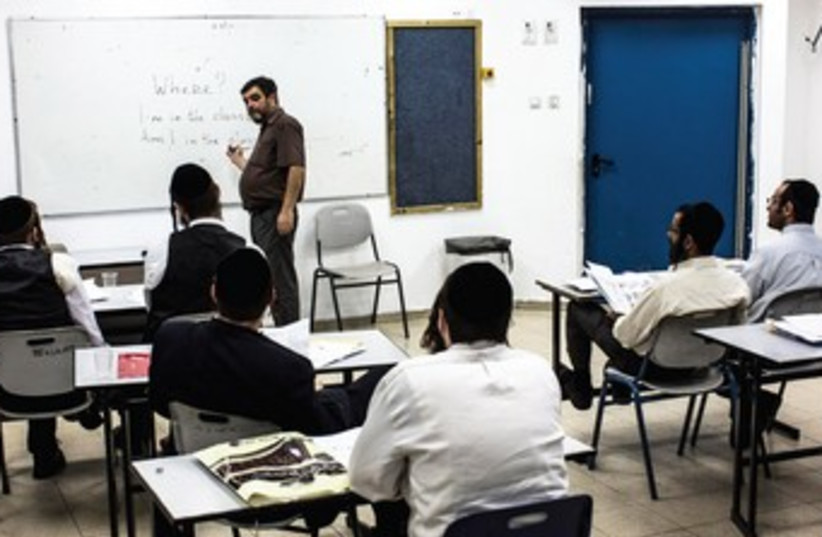 haredi in class in elad school student 370 (photo credit: Nir Elias/Reuters)
