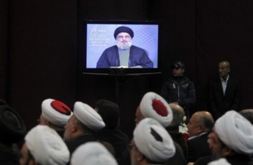 Hezbollah's Hassan Nasrallah addresses supporters in Beirut  (photo credit: REUTERS)