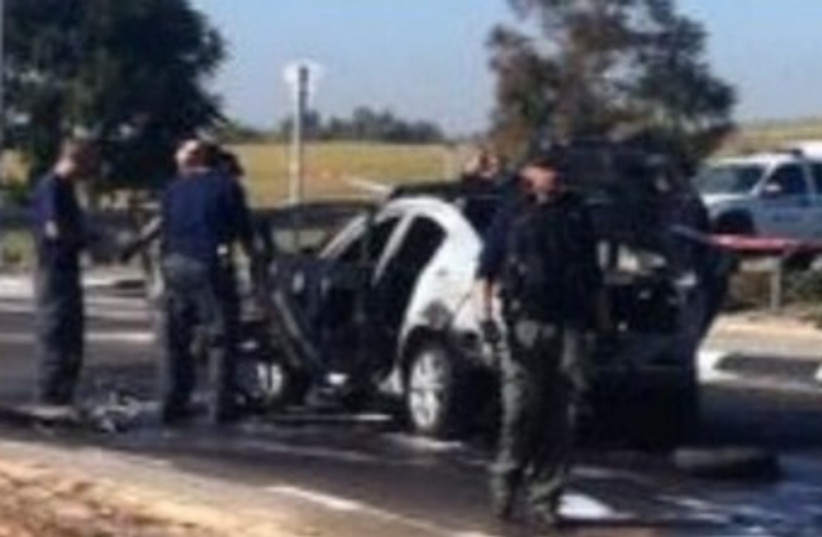 Car explosion scene in Rehovot 370 (photo credit: Courtesy Israel Police)