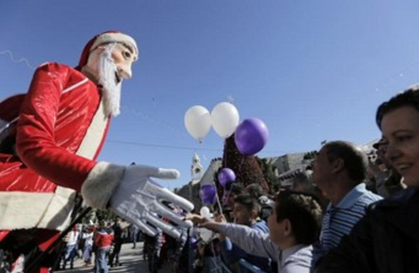Christmas eve celebrations in Bethlehem, December 24, 2013. (photo credit: REUTERS/Ammar Awad)
