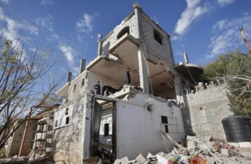 Gazan house damaged in IAF strike 370 (photo credit: REUTERS)