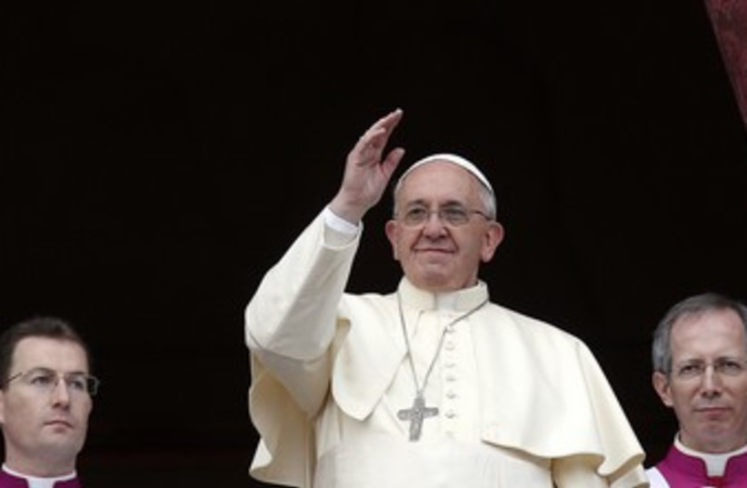 "Pope Francis waves as he delivers first ""Urbi et Orbi"". (photo credit: REUTERS)"