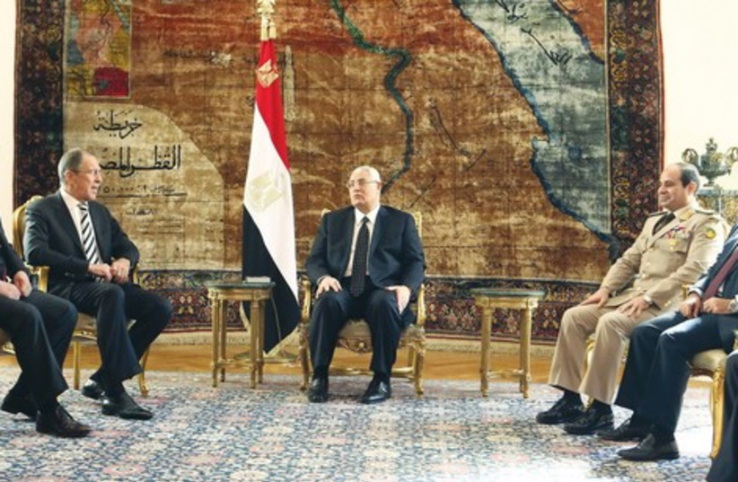 Egypt's interim President Mansour with Russia's FM Lavrov. (photo credit: REUTERS)