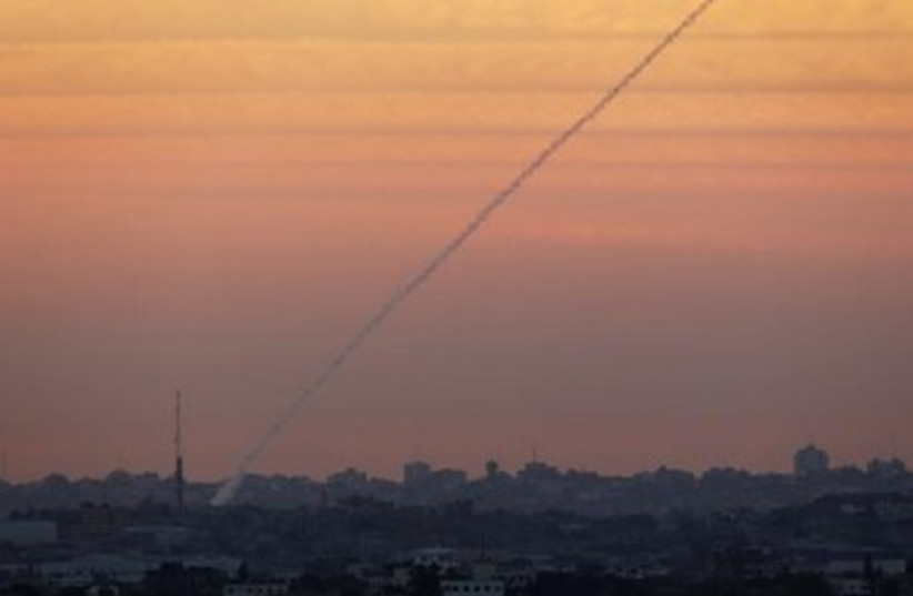Gaza rocket at sunset  (photo credit: REUTERS/ Darren Whiteside)