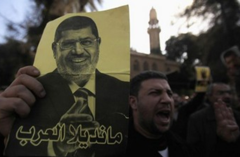 Egypt women Brotherhood protesting 370 (photo credit: REUTERS)