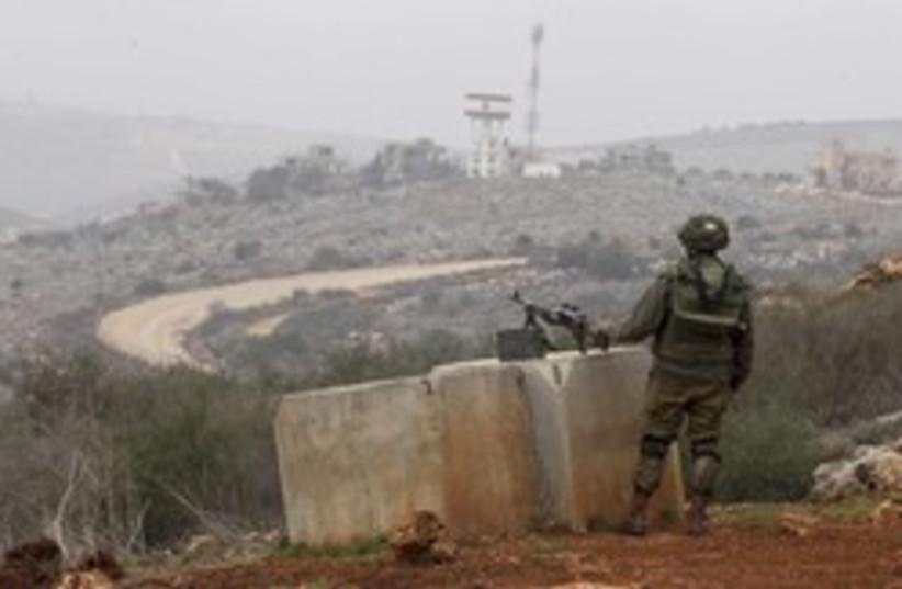 An IDF soldier monitors the Israel-Lebanon border. (photo credit: REUTER/Baz Ratner)
