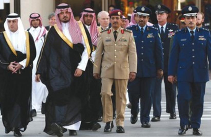 A Saudi delegation greeting US Secretary of Defense Hagel. (photo credit: REUTER)