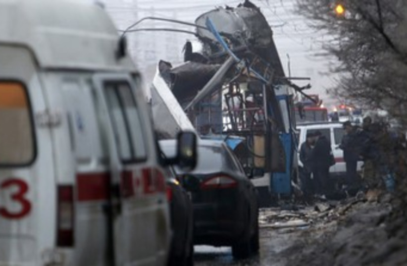 Authorities at the scene of an explosion in Volgograd (photo credit: Reuters)