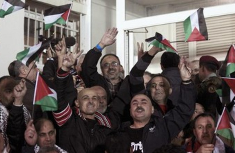 Celebrations in Ramallah as Palestinian prisoners released (photo credit: REUTERS/Ammar Awad)