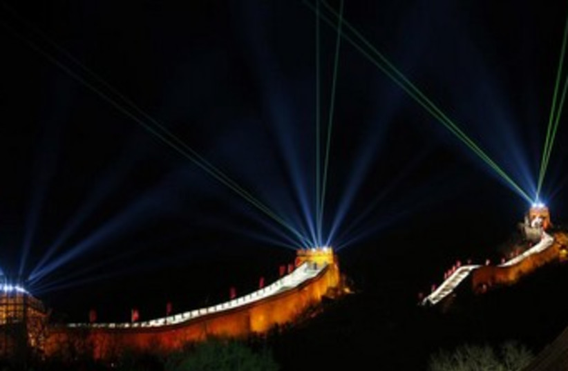 Lasers usher in the new year at the Great Wall in China (photo credit: Reuters)
