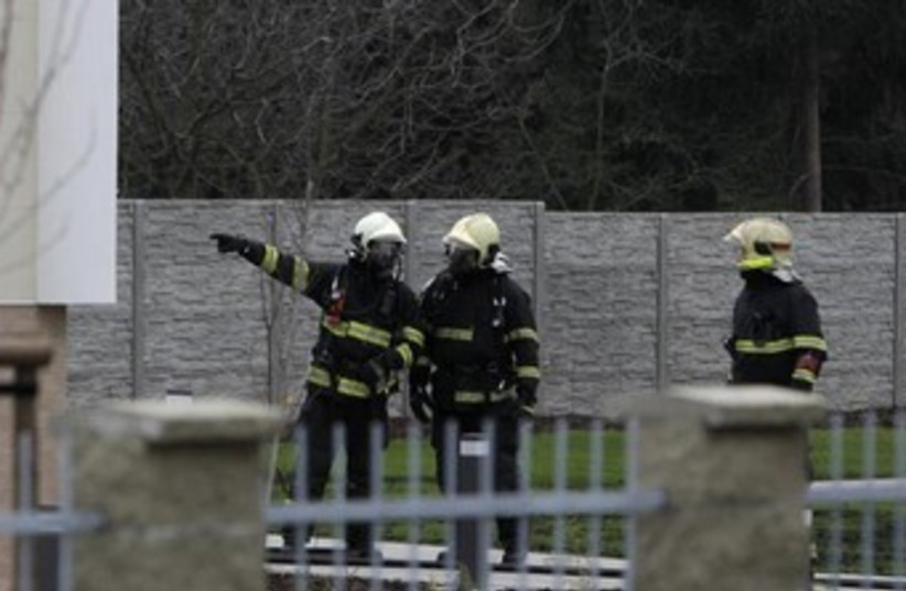 Firefighters search area after explosion. (photo credit: Reuters)