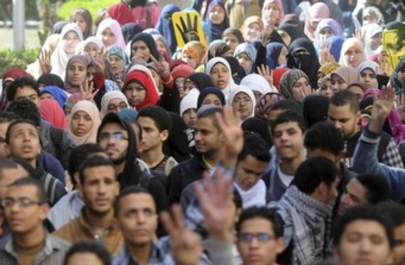 Cairo University students supporting the Muslim Brotherhood. (photo credit: REUTERS/Stringer)