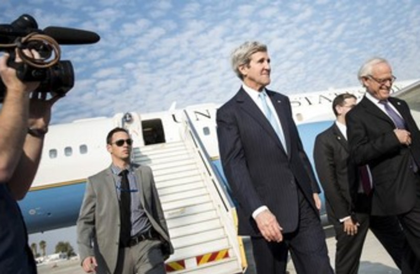 US Secretary of State Kerry and envoy Martin Indyk arrive (photo credit: Reuters)