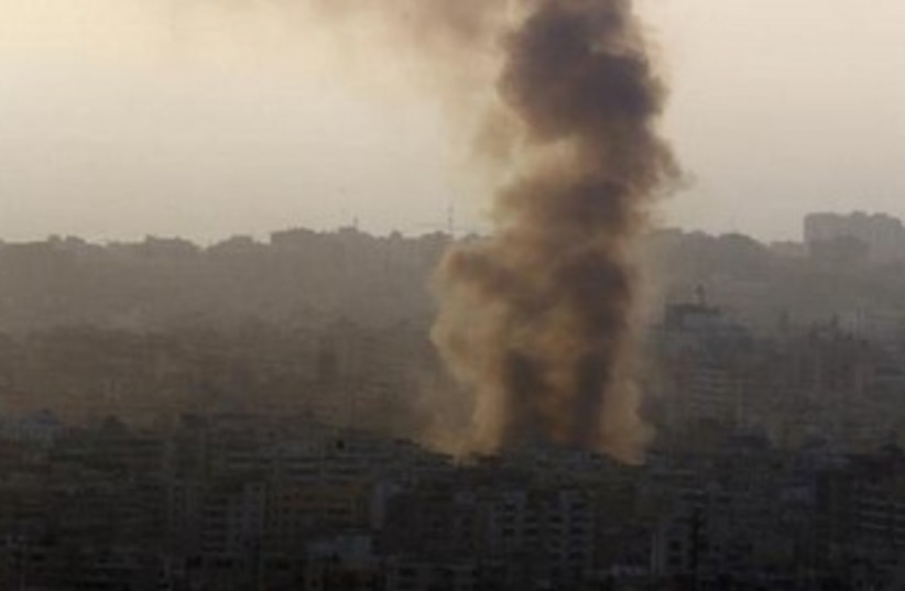 Smoke rises behind buildings in Beirut. (photo credit: REUTERS)