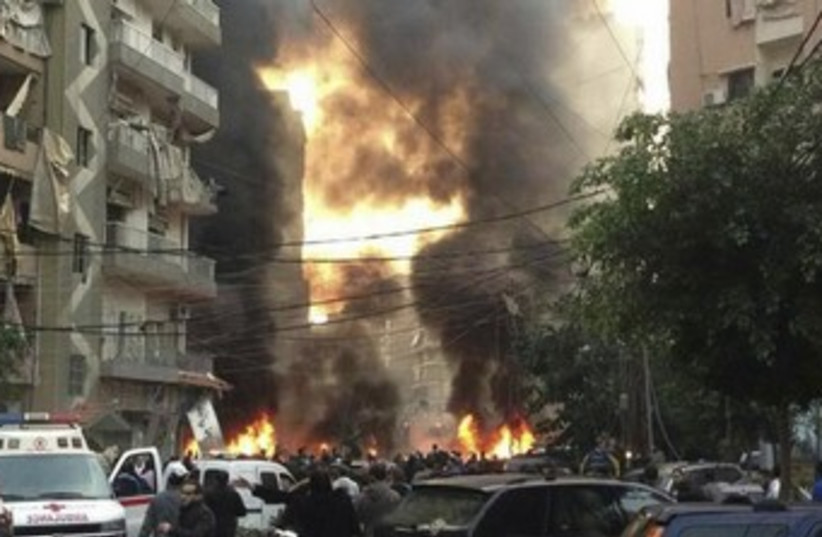The site of a blast in Beirut's southern suburbs. (photo credit: REUTERS/Jamal Sahili)