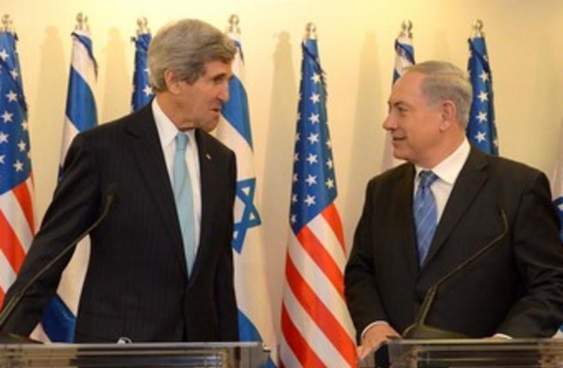 Prime Minister Binyamin Netanyahu and John Kerry. (photo credit: GPO/Haim Zach)