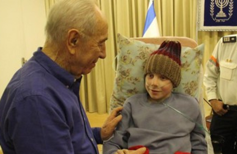 President Shimon Peres meets 12-year-old boy with cancer (photo credit: Yossef Avi Yair Engel)