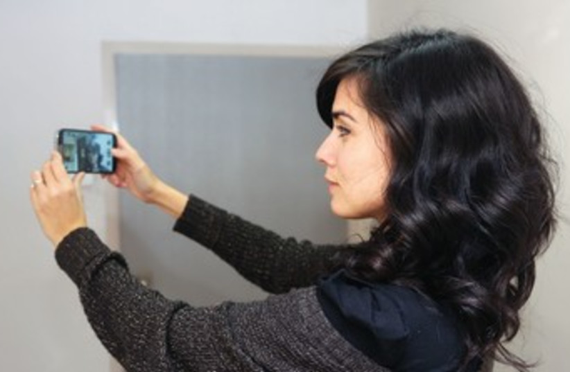 Woman taking selfie (photo credit: (Illustrative photo: Marc Israel Sellem/The Jerusa)