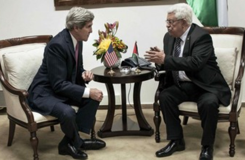 John Kerry and Mahmoud Abbas. (photo credit: Reuters)