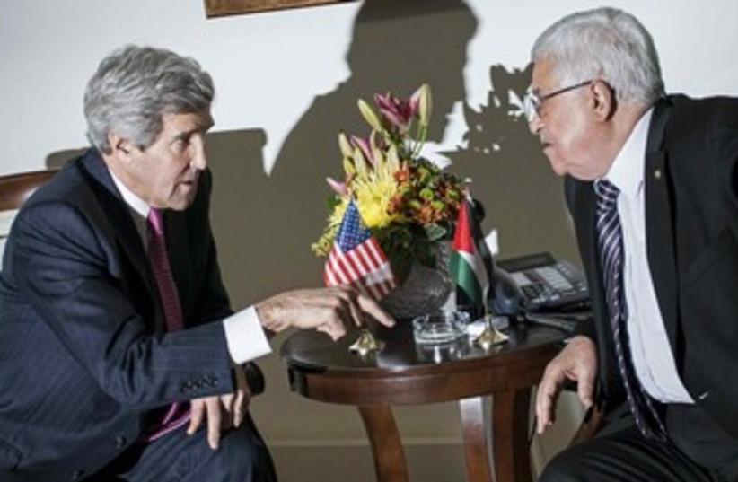 John Kerry and Mahmoud Abbas. (photo credit: Reuters)