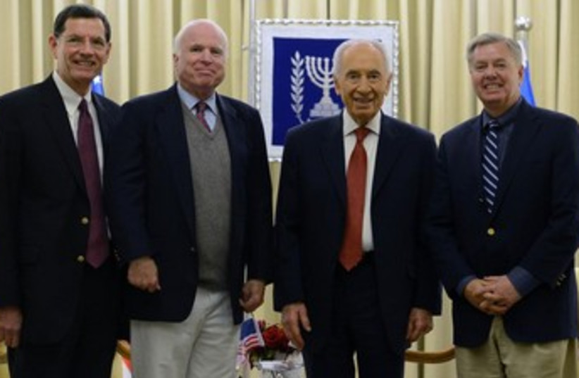 President Shimon Peres with US senators. (photo credit: Kobi Gideon/GPO)