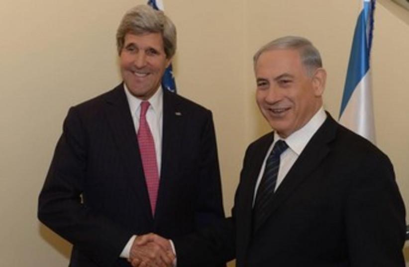 US Secretary of State John Kerry and PM Binyamin Netanyahu. (photo credit: Amos Ben Gershon/GPO)