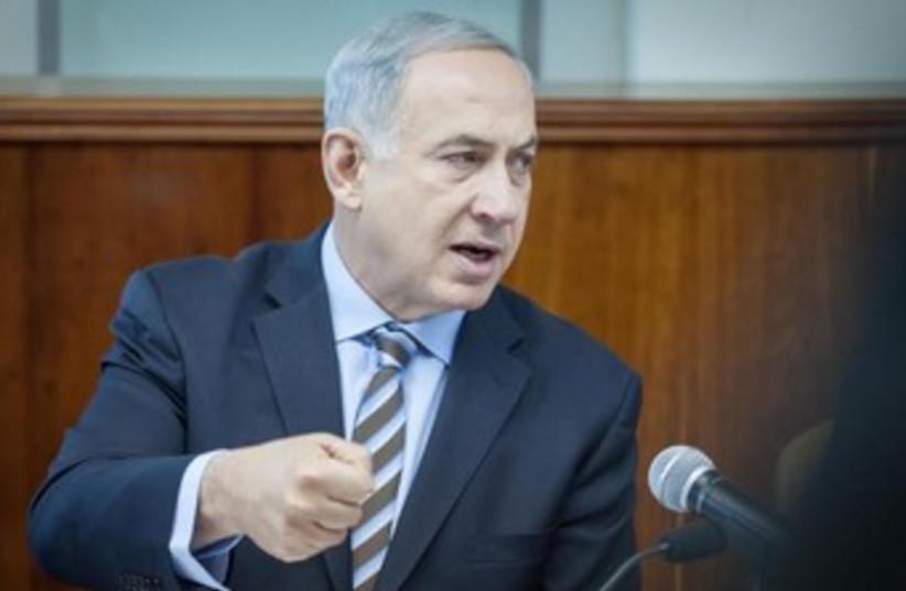 Prime Minister Binyamin Netanyahu at Sunday's cabinet meeting, January 5, 2014. (photo credit: Emil Salman/Pool/Haaretz)