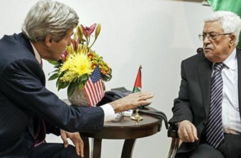 US Secretary of State John Kerry and PA President Mahmoud Abbas meeting in Ramallah, January 4, 2013. (photo credit: REUTERS/Brendan Smialowski/Pool)
