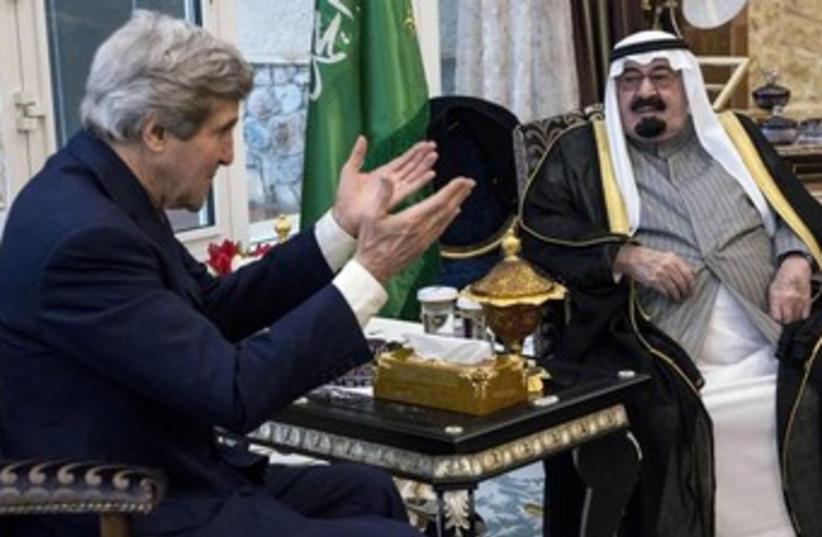 US Secretary of State John Kerry and Saudi Arabia's King Abdullah bin Abdulaziz al-Saud, January 5, 2014. (photo credit: REUTERS/Brendan Smialowski/Pool)