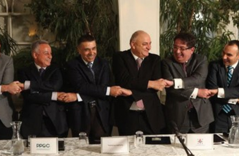 Officials from Delek and the Palestinian Authority (photo credit: Chen Galili)