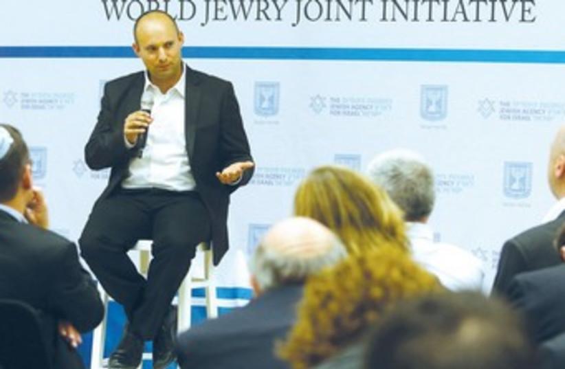 Naftali Bennett speaks to a forum on planning issue. (photo credit: Marc Israel Sellem/The Jerusalem Post)