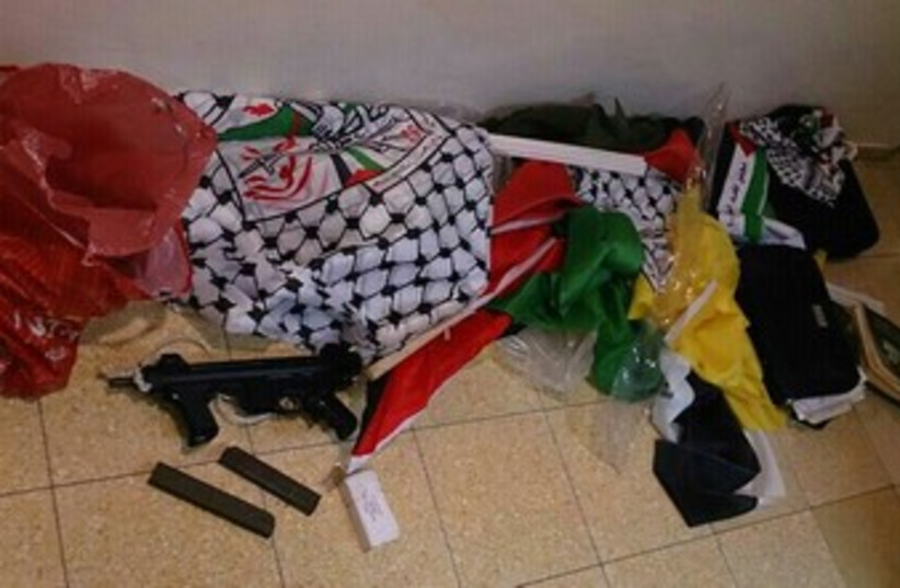 A weapons stash found at the home of an Abu Dis resident. (photo credit: Courtesy of police)