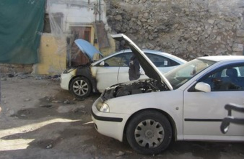 Cars burned in price tag attack Wednesday morning. (photo credit: B'Tselem)