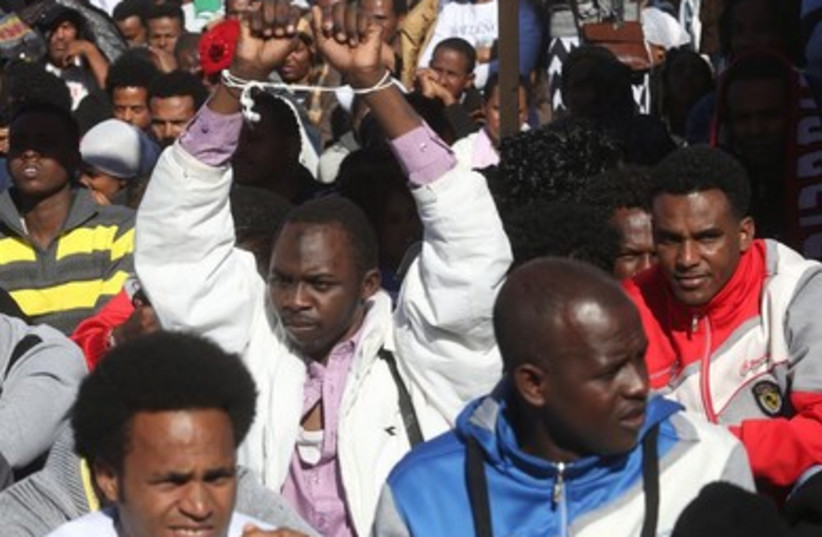 African migrants protest in front of the Knesset, January 8, 2014. (photo credit: Marc Israel Sellem/The Jerusalem Post))