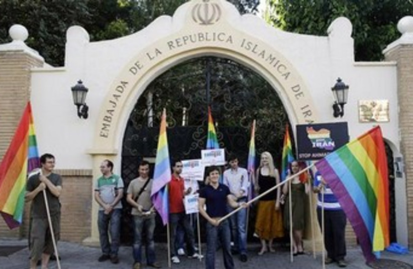 Spanish LGBT organization demonstrate against Iran's human rights violations outside Iranian embassy in Madrid, 2009. (photo credit: REUTERS/Susana Vera)