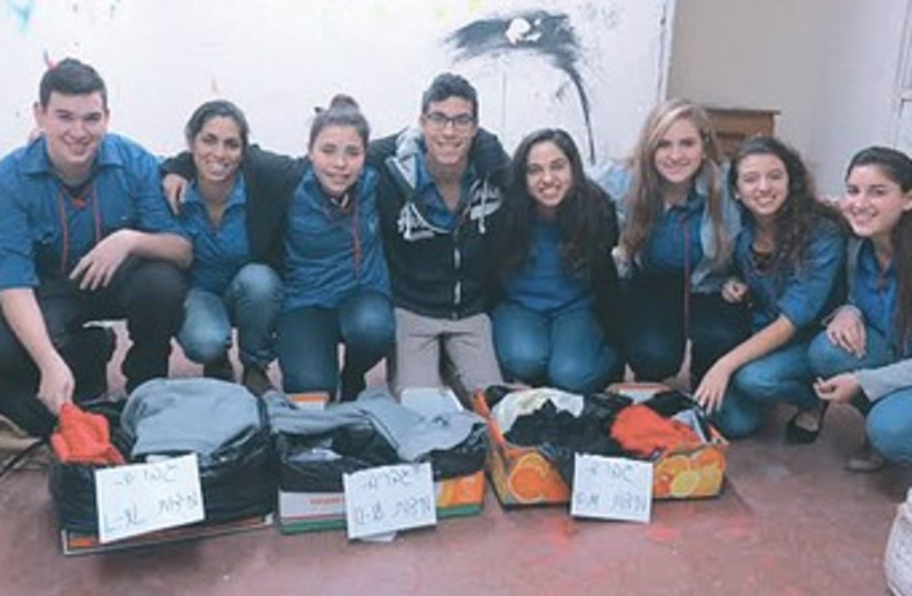 Israeli teenagers gather clothes for victims of the Syrian civil war. (photo credit: Operation Human Warmth)