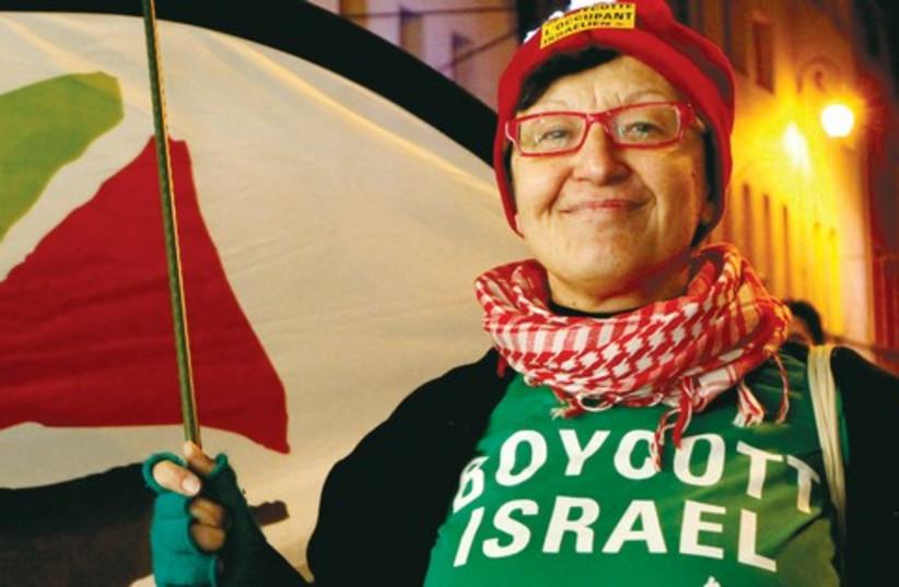 Woman in boycott Israel shirt (photo credit: Reuters)